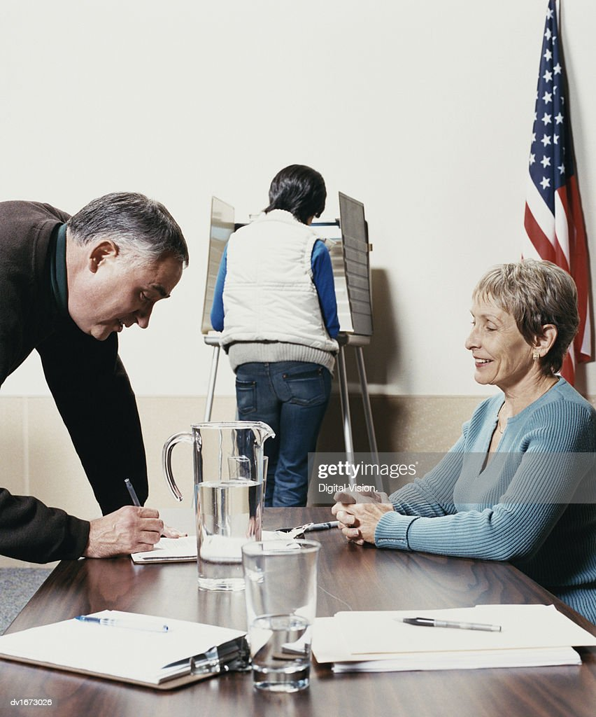 People Voting at a Polling Station : Stock Photo