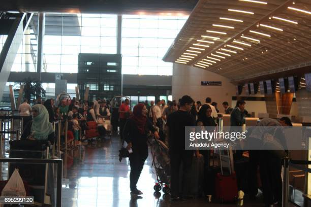 People wait ahead of their flights as air traffic flow continue as normal as before despite of a land sea and air blockade applied by Saudiled Arabic...