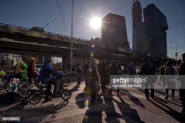 TOPSHOT People wait at a crossroad as they commute in the financial district in Beijing on February 10 2017 China's exports soared a forecastbeating...