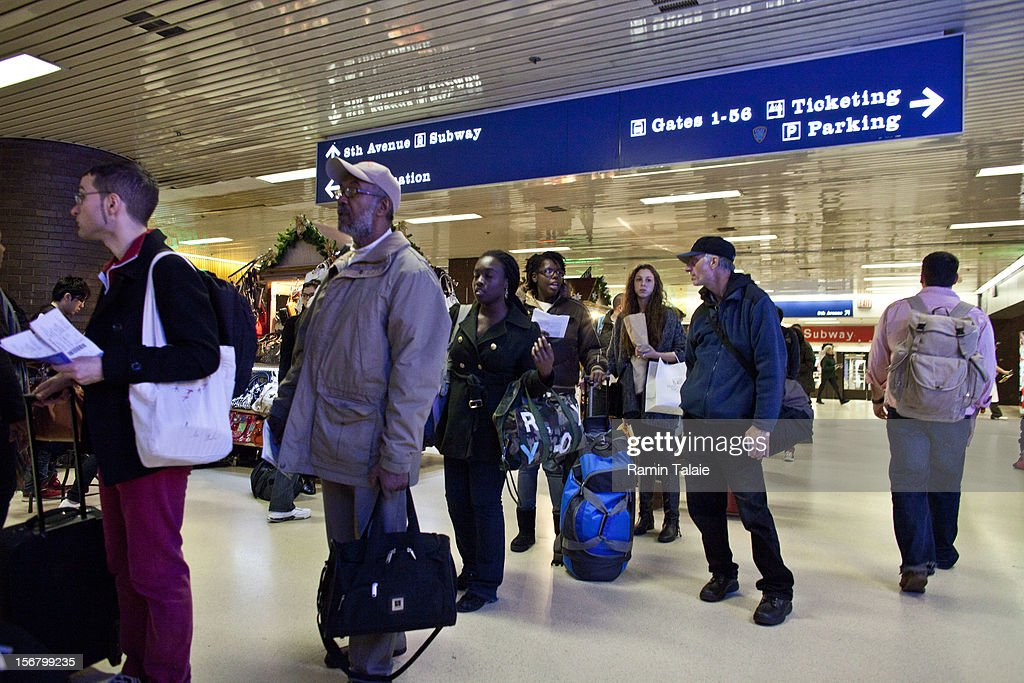 People wait at a gate at the New York Port Authority bus terminal in Manhattan on November 21, 2012 in New York City. The Port Authority of New York and New Jersey is expecting to handle a high number of travelers at its hubs, bridges, and tunnels ahead of the Thanksgiving holiday.