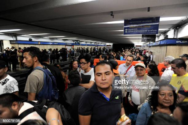 People wait at a subway station after the magnitude 71 earthquake jolted central Mexico damaging buildings knocking out power and causing alarm...