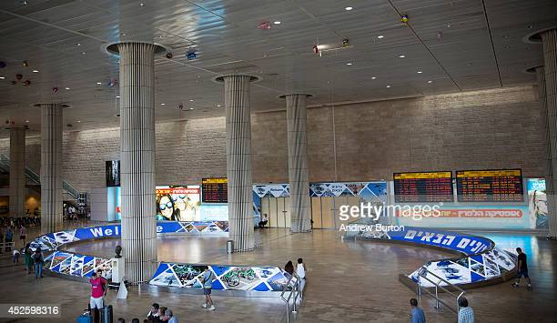 People wait at an empty arrivals gate at terminal three of Ben Gurion Airport on July 24 2014 in Tel Aviv Israel The Federal Aviation Administration...