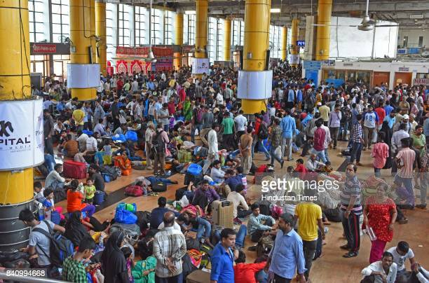 People wait at railway station due to delay of trains at Lokmanya Tilak Terminus on August 30 2017 in Mumbai India Heavy monsoon rains have brought...