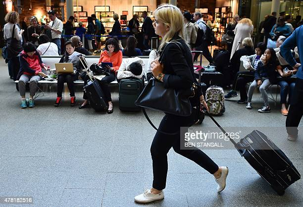 People wait at the Eurostar terminal at St Pancras station in London on June 23 2015 after disruption on the French side of the Channel Tunnel caused...