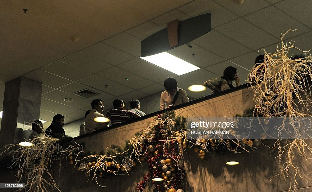 People wait at the Mount Elizabeth hospital in Singapore, on December 29, 2012. The medical condition of an Indian gang-rape victim has 'taken a turn for the worse' with 'signs of severe organ failure', the Singapore hospital treating her said in a statement issued late on December 28, 2012.
