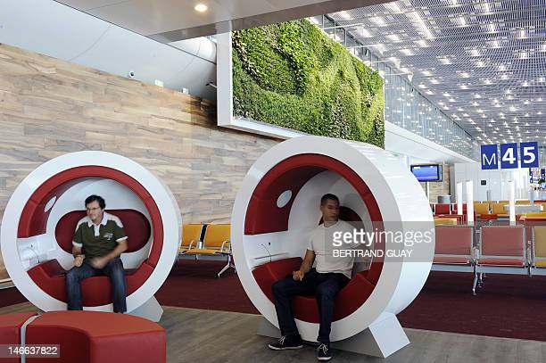 People wait at the new boarding hall of Terminal 2E S4 at RoissyCharlesdeGaulle airport in RoissyenFrance northern Paris on June 21 prior to taking...