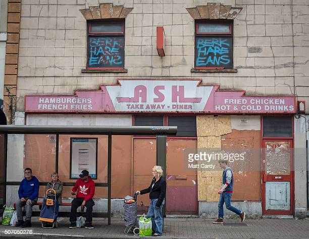 People wait for a bus in front of a empty takeaway restaurant in Bristol on August 3 2015 in Bristol England