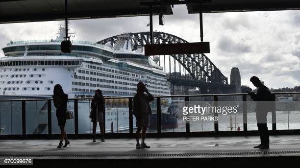 People wait for a train at Circular Quay in Sydney on April 19 2017 Australia's controversial decision to scrap a visa programme for temporary...