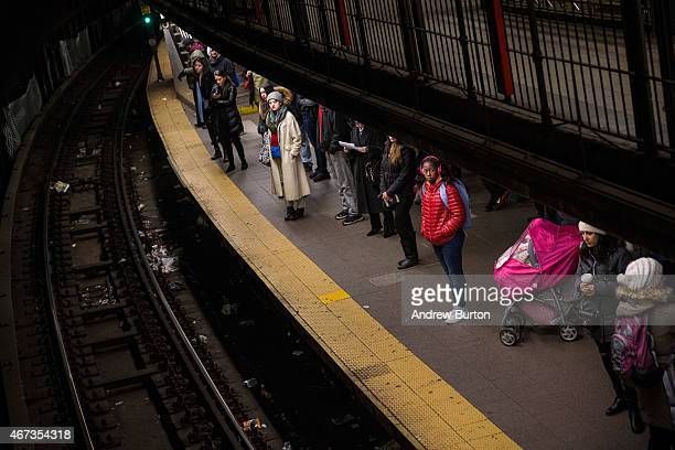 People wait for a train at the Union Square subway station on March 23 2015 in New York City Frustrations are mounting in some commuters against the...