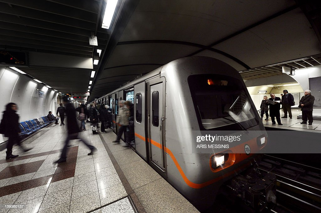 People wait for a train on a platform of a Athens' metro station on January 11, 2013. AFP PHOTO / ARIS MESSINIS