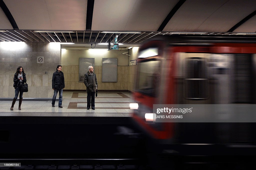 People wait for a train on a platform of a Athens' metro station on January 11, 2013.
