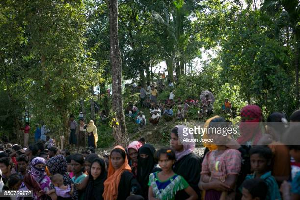 COX'S BAZAR BANGLADESH SEPTEMBER 21 People wait for aid in the Balukhali Rohingya refugee camp on September 21 2017 in Cox's Bazar Bangladesh Over...