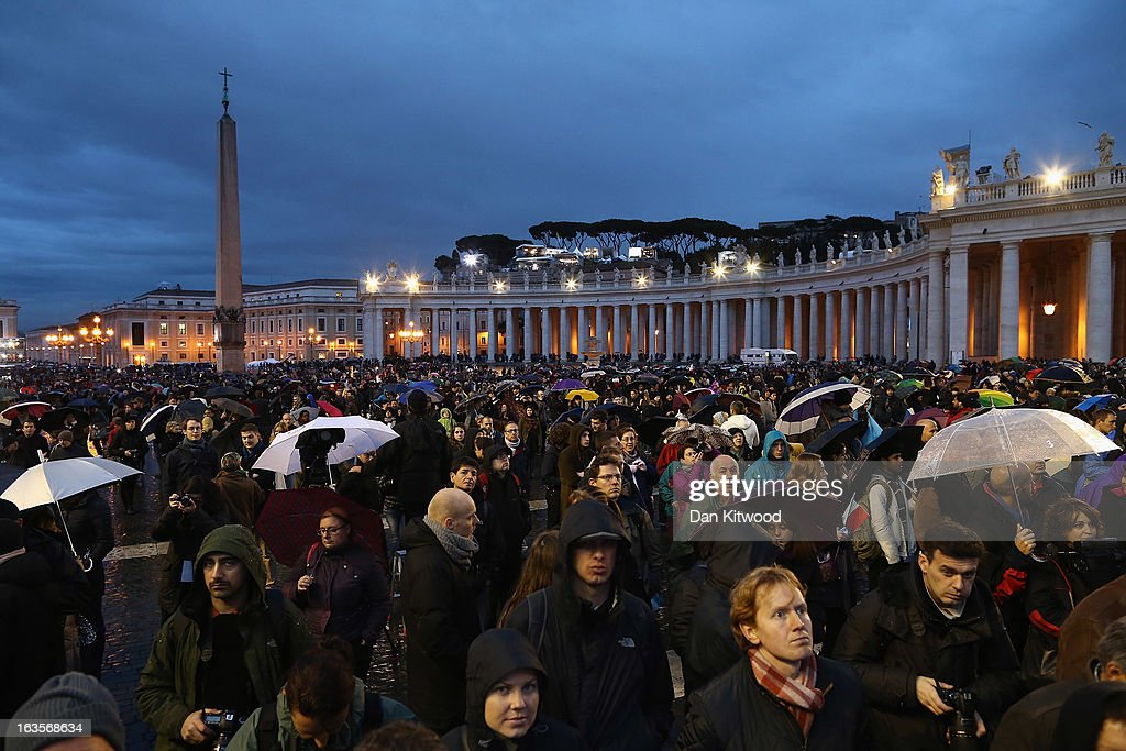 People wait for an indication as to whether the College of Cardinals have elected a new Pope in St Peter's Square on March 12, 2013 in Vatican City, Vatican. Pope Benedict XVI's successor is being chosen by the College of Cardinals in Conclave in the Sistine Chapel. The 115 cardinal-electors, meeting in strict secrecy, will need to reach a two-thirds-plus-one vote majority to elect the 266th Pontiff.