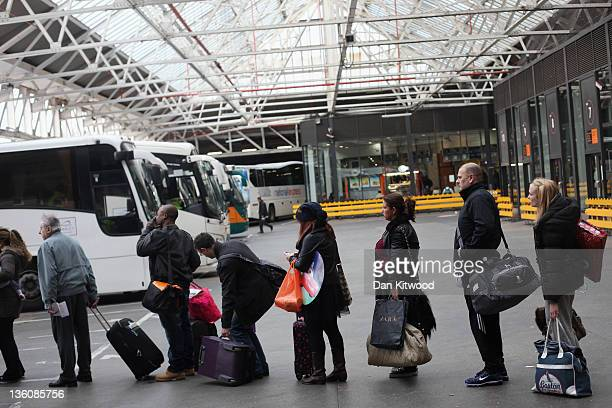 People wait for coaches at Victoria Coach Station on December 23 2011 in London England The AA estimates 18 million vehicles will be traveling over...