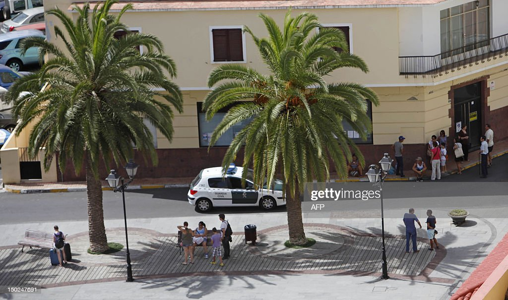 People wait for evacuation in Vallehermoso, on August 13, 2012, on the Spanish canary island of La Gomera. Wildfires killed two people in southeastern Spain and forced thousands to evacuate in the Canary Islands where flames ravaged a rare nature reserve, authorities said Monday.