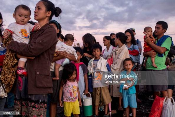 People wait for flights out of Tacloban Airport in the early hours of the morning on November 15 2013 in Leyte Philippines Typhoon Haiyan which...