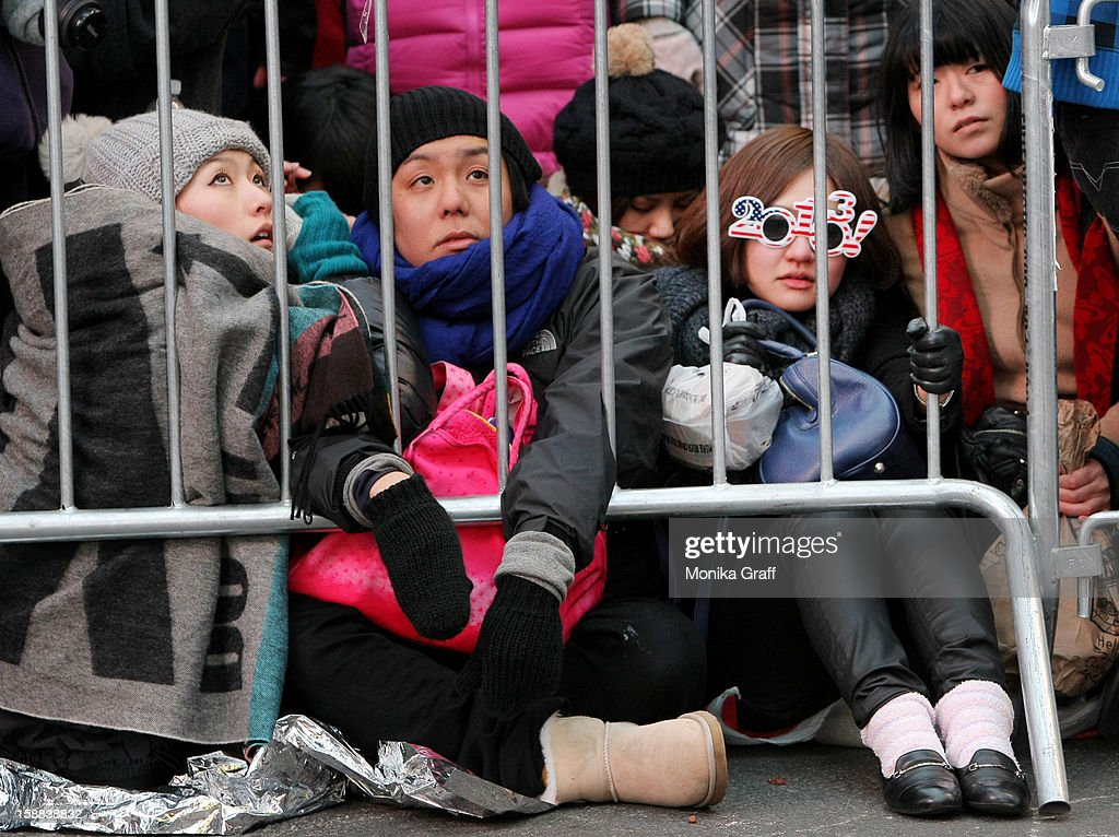 People wait for hours in near-freeing temperatures in Times Square to celebrate New Year's Eve on December 31, 2012 in New York City. Approximately one million people are expected to ring in the new year in Times Square.