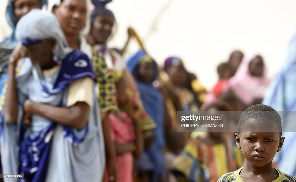 People wait for medical aid provided by military doctors on June 6 2015 in M'Bouna in the Timbuktu region during the joint operation 'La Madine 3'...