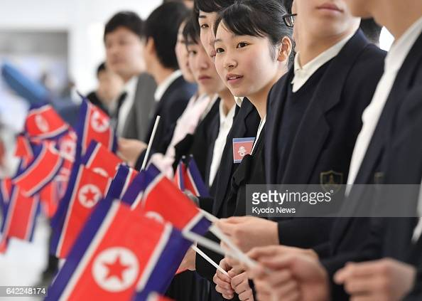 People wait for the arrival of North Korean athletes and accompanying officials on Feb 17 at New Chitose Airport on Japan's northernmost main island...