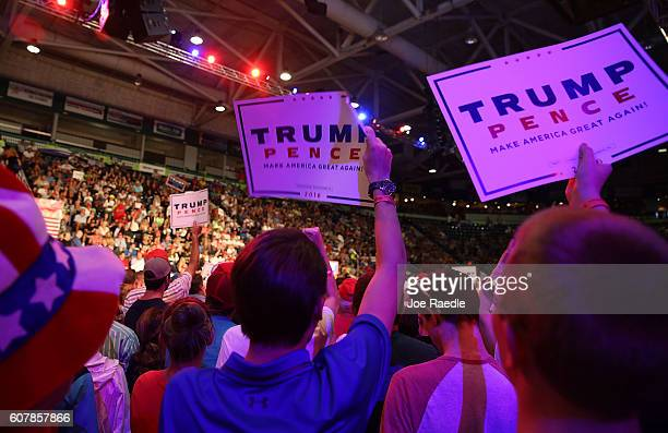People wait for the arrival of Republican presidential candidate Donald Trump during a campaign rally at the Germain Arena on September 19 2016 in...