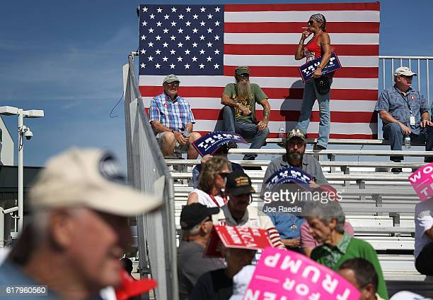 People wait for the arrival of Republican presidential candidate Donald Trump for his campaign rally at the Million Air Orlando which is at Orlando...