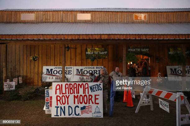 People wait for the arrival of Republican Senatorial candidate Roy Moore to speak during a campaign event at Jordan's Activity Barn on December 11...