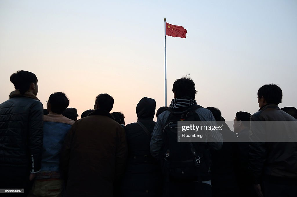 People wait for the daily flag-lowering ceremony at Tiananmen Square in Beijing, China, on Thursday, March 14, 2013. Xi Jinping was named China's president by the national legislature, replacing Hu Jintao in the country's most rapid formal transfer of power in more than a generation. Photographer: Tomohiro Ohsumi/Bloomberg via Getty Images