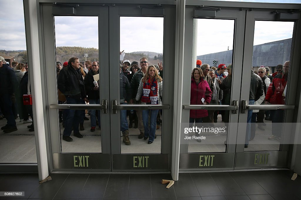 People wait for the doors to open at a rally for Republican presidential candidate Donald Trump at Plymouth State University on February 7, 2016 in Holdernes, New Hampshire. Democratic and Republican Presidential are stumping for votes throughout New Hampshire leading up to the Presidential Primary on February 9th.