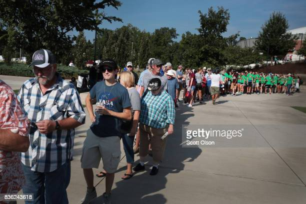 People wait for the gates to open at Saluki Stadium on the campus of Southern Illinois University to watch the solar eclipse on August 21 2017 in...