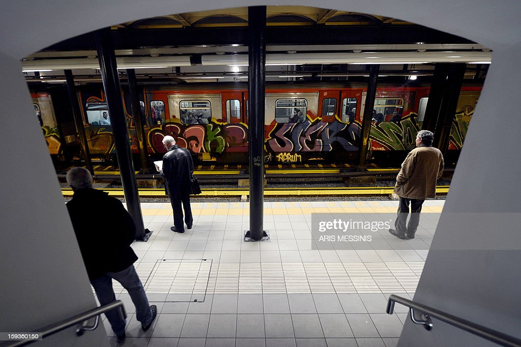 People wait for the metro in a Athens' metro station, on January 11, 2013.