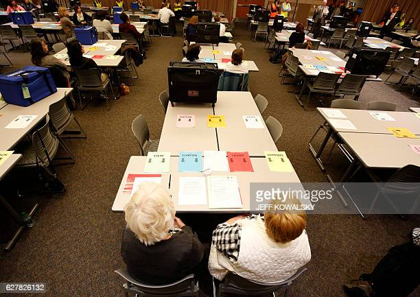 People wait for the recount of ballots cast in Oakland County Michigan from the 2016 US presidential race to be recounted at the Oakland County...