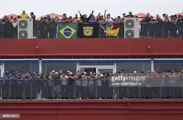 People wait for the start of the MotoGP race of the Argentina Grand Prix at Termas de Rio Hondo circuit in Santiago del Estero Argentina on April 9...