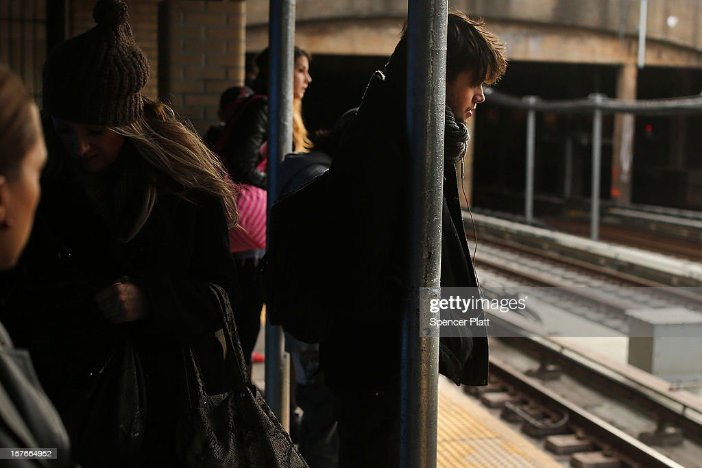 People wait for the subway at a stop in Brooklyn two days after a man was pushed to his death in front of a train on December 5, 2012 in New York City. The incident was caught by a photographer and has since raised questions as to why someone didn't help the man before the train struck him. The New York City subway system, with 468 stations in operation, is the most extensive public transportation system in the world. It is also one of the world's oldest public transit systems, with the first underground line of the subway opening on October 27, 1904.