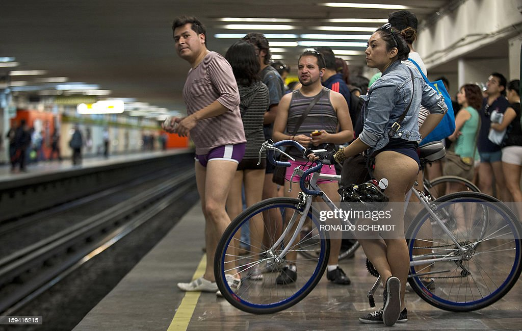 People wait for the train at a subway station during the worldwide 'No Pants Subway Ride' event in Mexico City on January 13, 2013. The 'No Pants Subway Ride', though in its 12th year, still surprises fellow passengers on public transit, and is spreading to other cities across the globe.