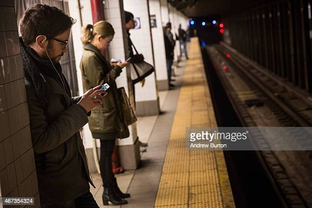 People wait for the train at the DelanceyEssex subway station on March 23 2015 in New York City Frustrations are mounting in some commuters against...