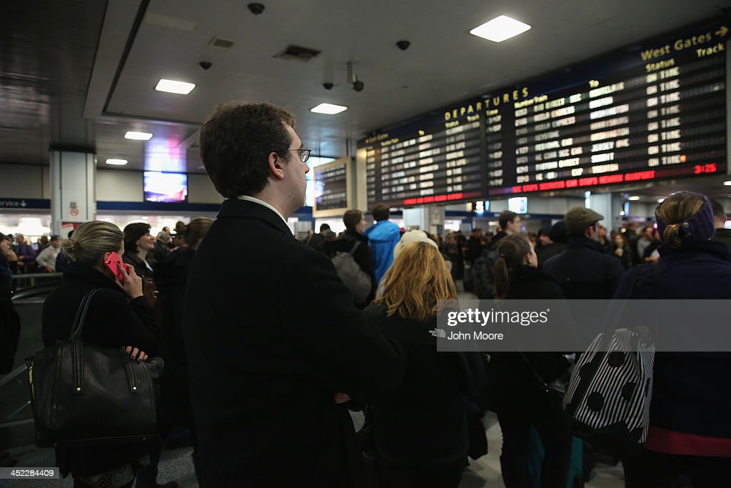 People wait for their Amtrak train departure in Pennsylvania Station on the busiest travel day of the year November 27, 2013 in New York City. Even on an average day, some 650,000 people transit through Penn Station, twice as many as America's most-used airport in Atlanta and busier than the New York area's three major airports combined.