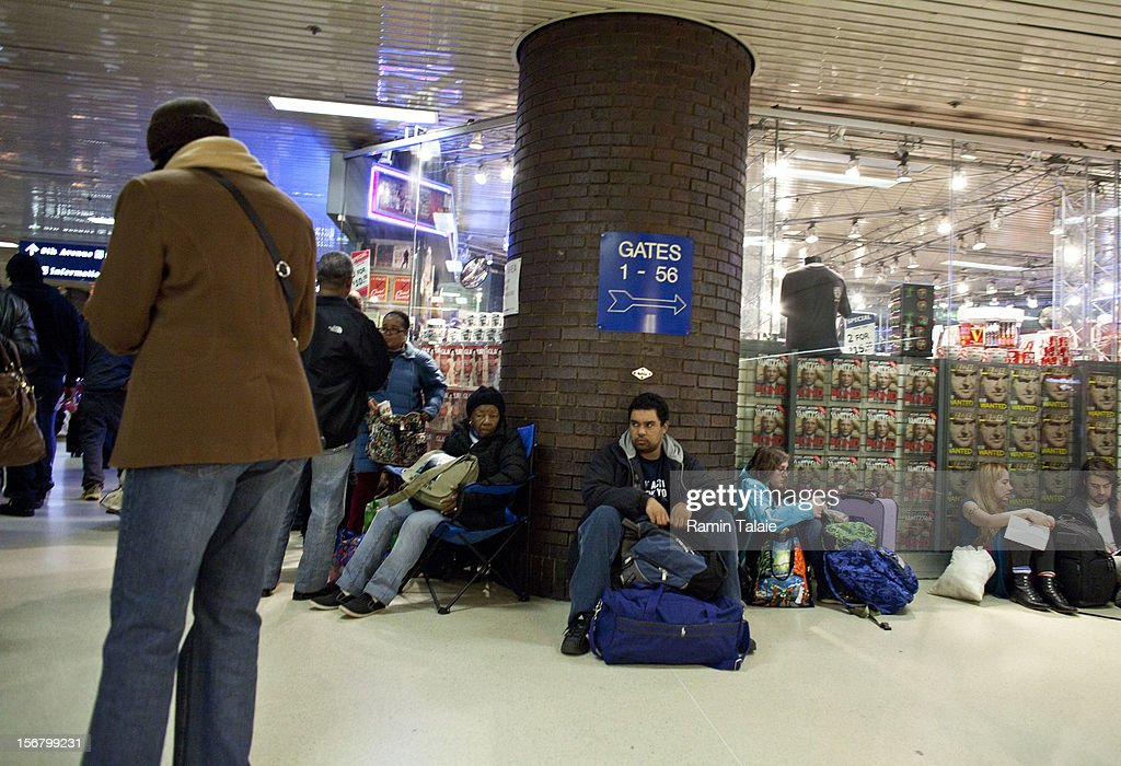 People wait for their bus at the New York Port Authority bus terminal in Manhattan on November 21, 2012 in New York City. The Port Authority of New York and New Jersey is expecting to handle a high number of travelers at its hubs, bridges, and tunnels ahead of the Thanksgiving holiday.
