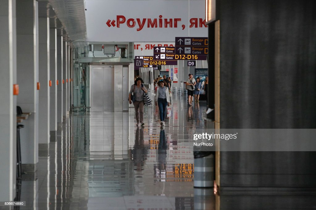 "People wait for their flight at a concourse of 'Boryspil' Airport on 21 August 2017 in Kiev, Ukraine. Because of the increasing of The International Airport ""Boryspil"" passengers traffic up to 18.8% the past year, the management of airport decided to improve the infrastructure and to implement seven large infrastructure projects in the country's largest airport for a total of about $ 500 million over the next five years."