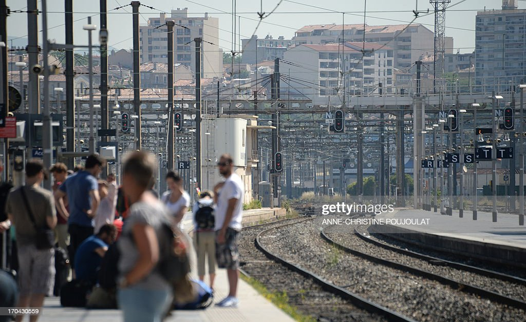 People wait for trains at the Saint Charles train station during a strike by French SNCF railway company employees on June 13, 2013, in Marseille. The strike was called by unions hostile to reforms of the train services sector recently proposed by the French government on May 29. AFP PHOTO / ANNE-CHRISTINE POUJOULAT