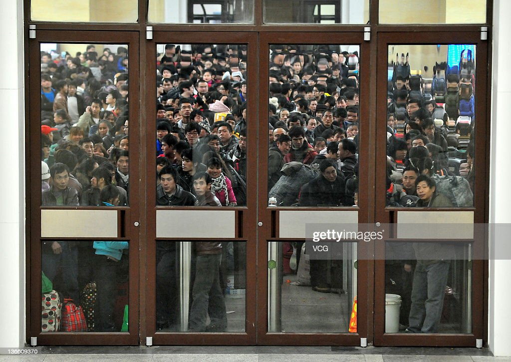 People wait for trains home at Qingdao Railway Station on January 8, 2012 in Qingdao, China. China's annual Spring Festival travel rush begins today as authorities estimate 3.158 billion passenger journeys will be made for the Chinese lunar new year during the 40-day travel period.