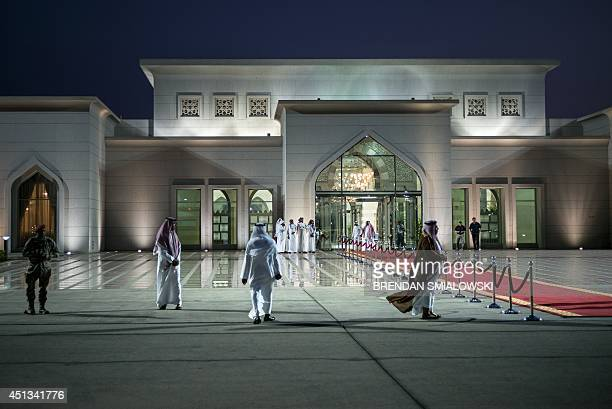 People wait for US Secretary of State John Kerry to depart King Abdulaziz International Airport June 27 2014 in Jeddah Saudi Arabia Kerry who was in...