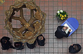 People wait in a line to sign a book of condolence in the city hall on March 13 2009 in Winnenden Germany 17 year old Tim Kretschmer opened fire on...