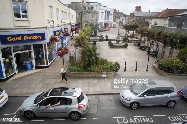 People wait in a parked car in Camborne on July 24 2017 in Cornwall England Figures released by Eurostat in 2014 named the British county of Cornwall...