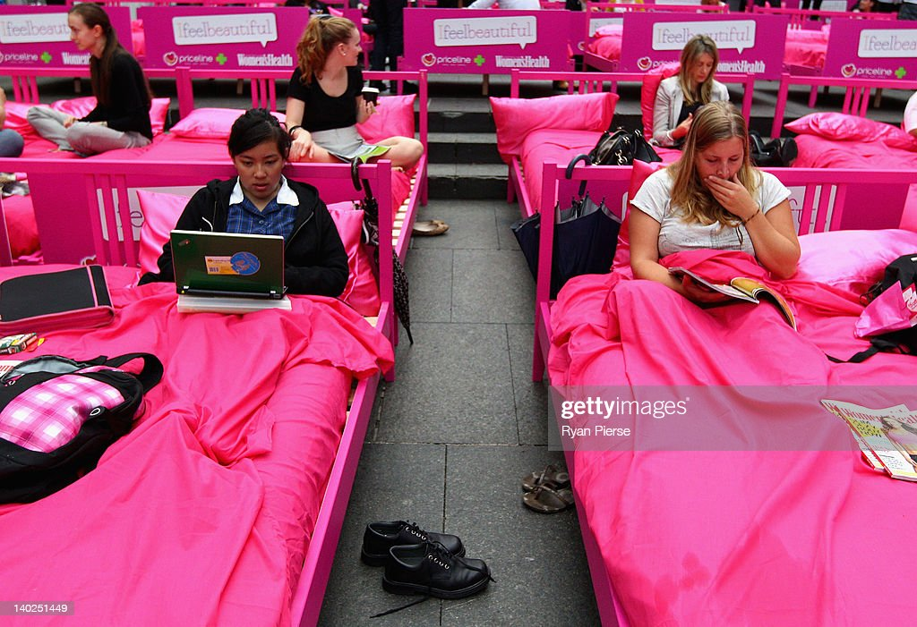 People wait in bed during the The World's Biggest Breakfast in Bed Guinness World Record Attempt at Martin Place on March 2, 2012 in Sydney, Australia.