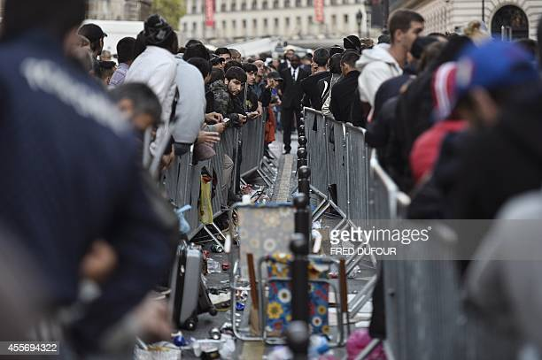 People wait in front of the Apple Store in Paris to buy the latest iPhone the iPhone 6 on September 19 2014 in Paris Apple says more than four...