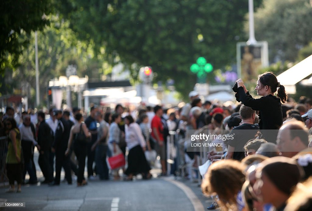 People wait in front of the Palais des Festival, during the 63rd Cannes Film Festival on May 22, 2010 in Cannes.