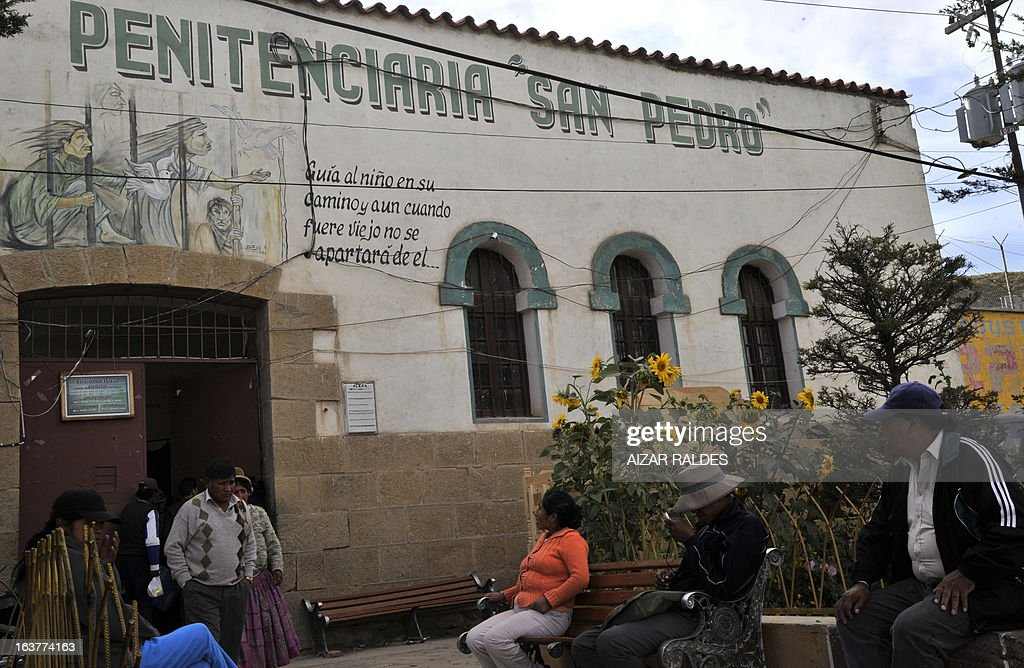People wait in front of the San Pedro prison where 12 supporters of Brazilian Corinthians football team are being held, in Oruro, 240 km southwest of La Paz, Bolivia on March 15, 2013. Supporters were detained due to incidents during the Libertadores Cup football match against Bolivian San Jose, in which 14-year-old Kevin Beltran was killed after he was reached by a flare thrown by a supporter of Corinthians. AFP PHOTO/Aizar RALDES