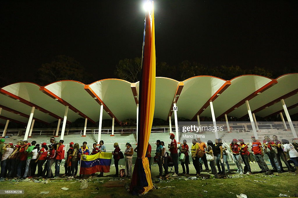 People wait in line after dark to view the remains of late Venezuelan President Hugo Chavez outside the Military Academy on March 7, 2013 in Caracas, Venezuela. Countless Venezuelans waited on a mile-long line to pay their last respects to Chavez before his funeral tomorrow.