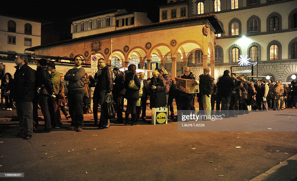 People wait in line at night to vote in the PD Primary Elections on November 25, 2012 in Florence, Italy. None of the five candidates won a 50 percent majority vote today. <a gi-track='captionPersonalityLinkClicked' href=/galleries/search?phrase=Matteo+Renzi&family=editorial&specificpeople=6689301 ng-click='$event.stopPropagation()'>Matteo Renzi</a>, who received more than 36 percent of the vote, will face the head of Italy's Democratic Party Pier Luigi Bersani in a runoff next weekend to choose the center-left leader that will be the candidate for the next Italian election to succeed Mario Monti.