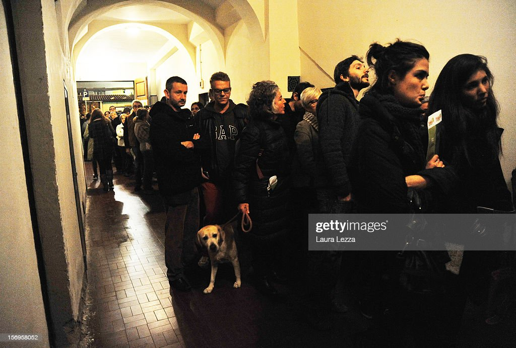People wait in line at night to vote in the PD Primary Elections on November 25, 2012 in Florence, Italy. None of the five candidates won a 50 percent majority vote today. Matteo Renzi, who received more than 36 percent of the vote, will face the head of Italy's Democratic Party Pier Luigi Bersani in a runoff next weekend to choose the center-left leader that will be the candidate for the next Italian election to succeed Mario Monti.